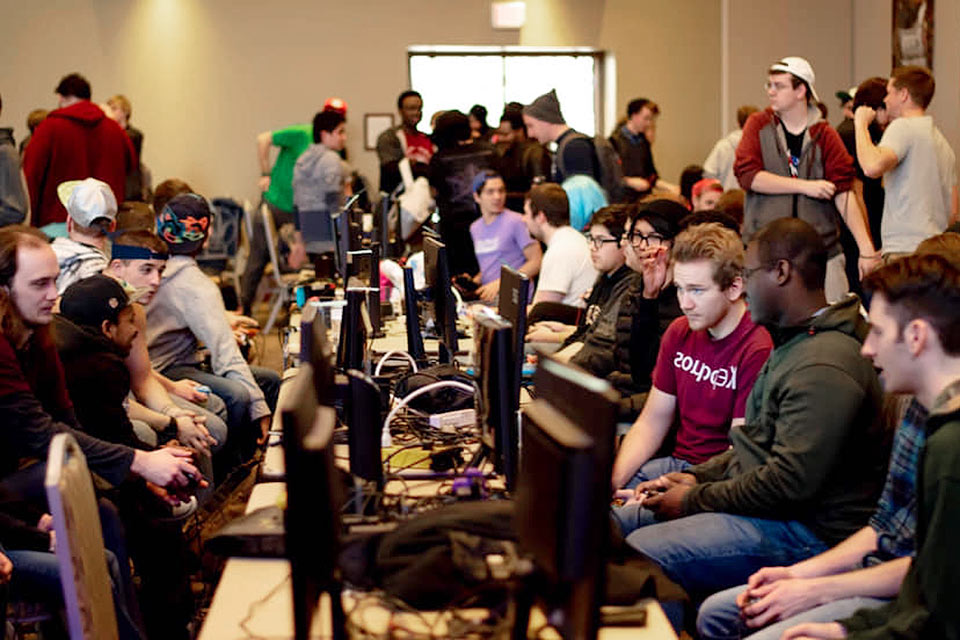 Players competing at Smash Out videogame tournament in 2018.